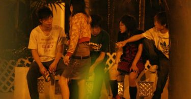 A group of youths taking drug in a park next to the disco. Underage youths are not allowed to enter the disco because police patrol around the area overnight as part of a surge in police activity in bars and nightclubs after the 13-year-old girl Chek Wai-yin died of drug abuse in Mongkok Road on July 26.  29 July 2006